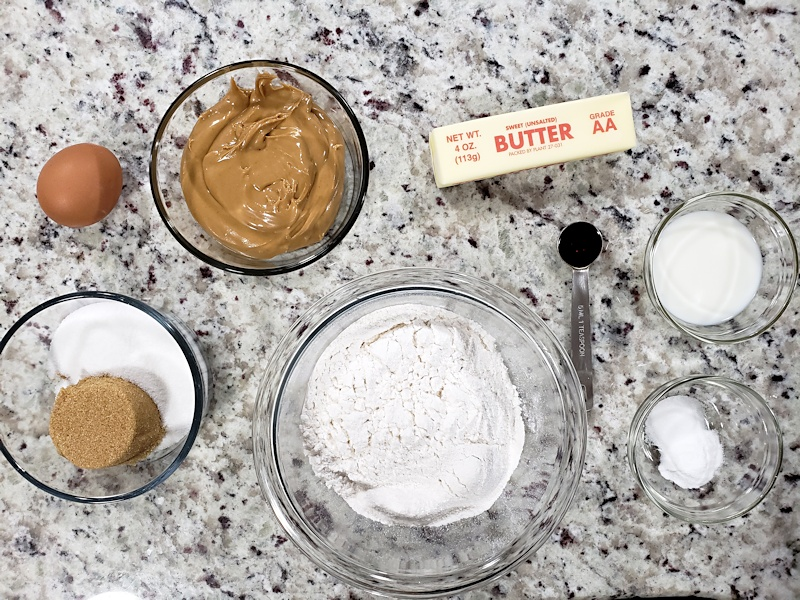 Ingredients to make peanut butter cookies on a counter top.