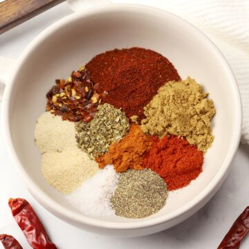 A bowl filled with various spices.