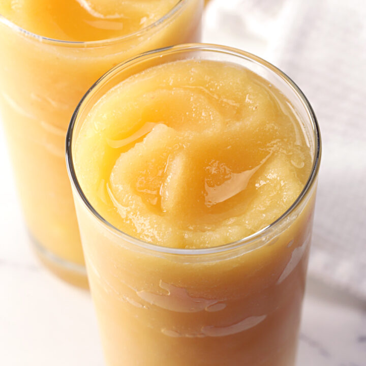 Ginger peach vodka slush swirled in a glass.