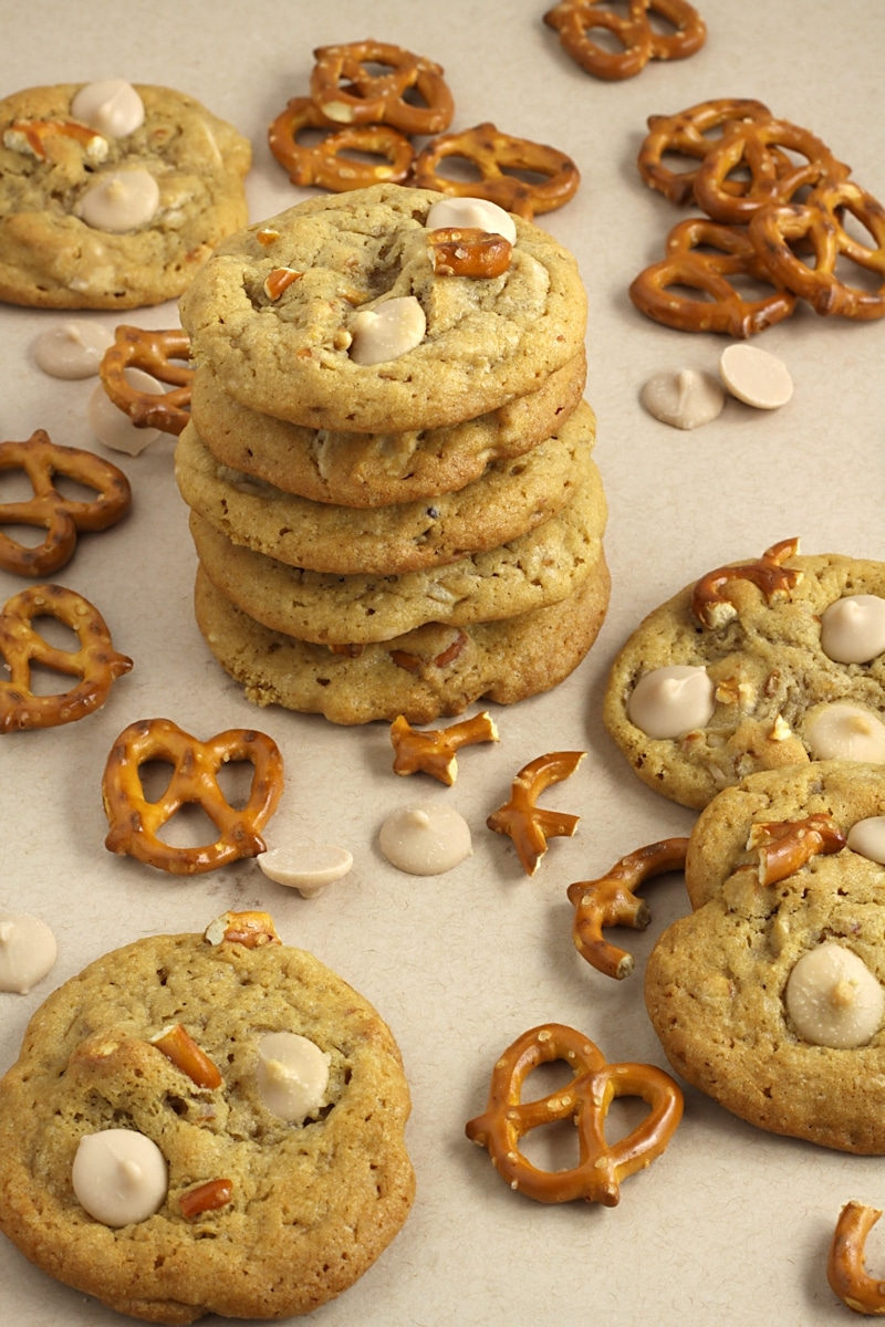 A stack of cookies with pretzel pieces and caramel chips.