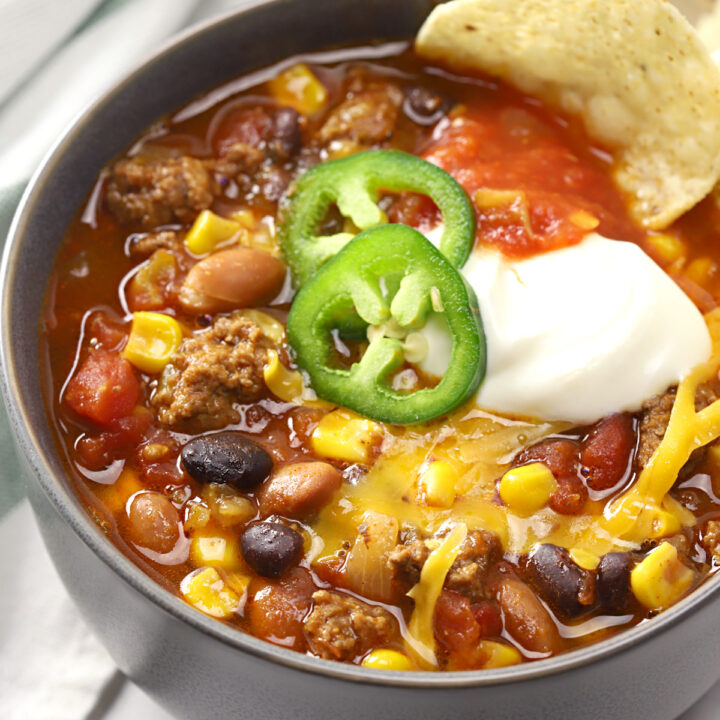 Bowl of taco chili topped with jalapeno slices.