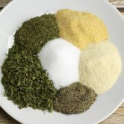 A white plate filled with herbs and spices.