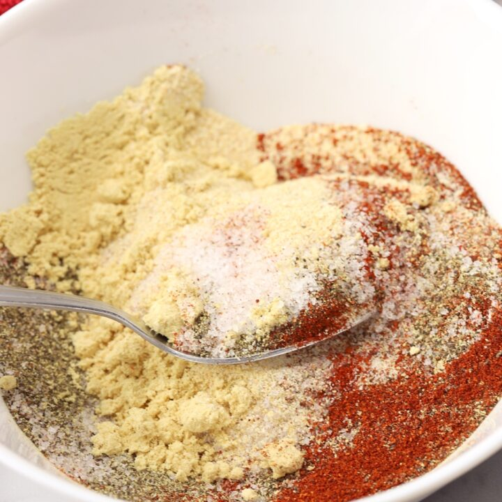 Mixing spices with a metal spoon.