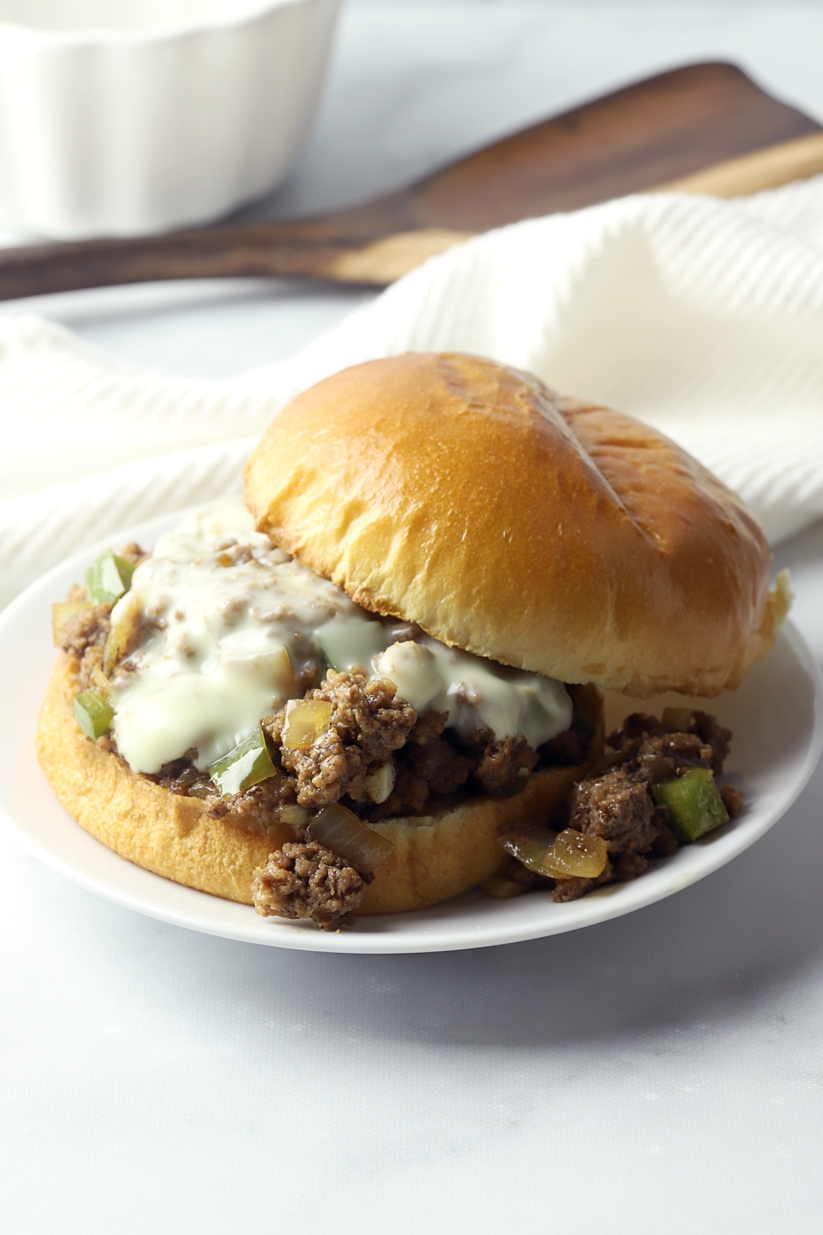 A sloppy joe on a white plate.