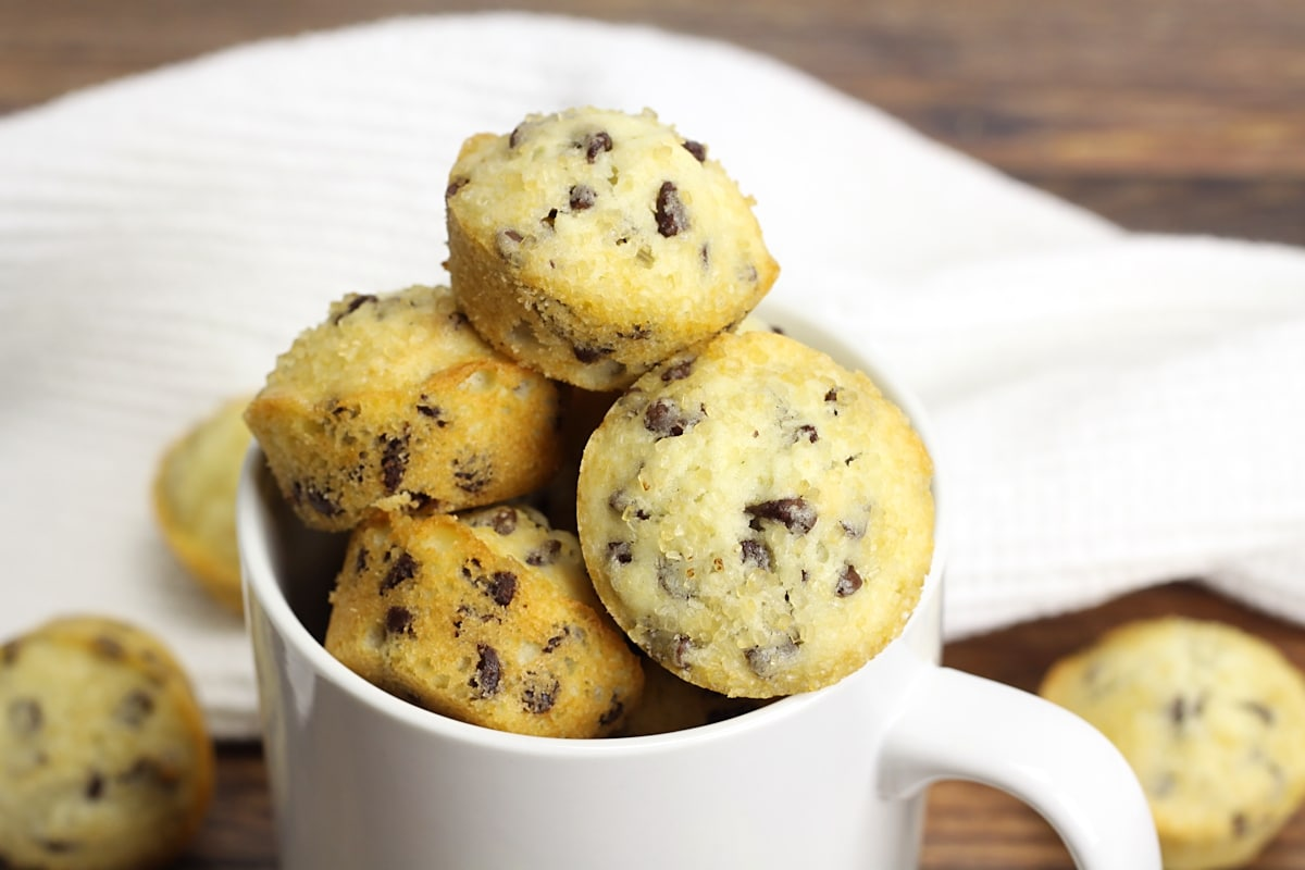 Mini muffins stacked in a coffee mug.
