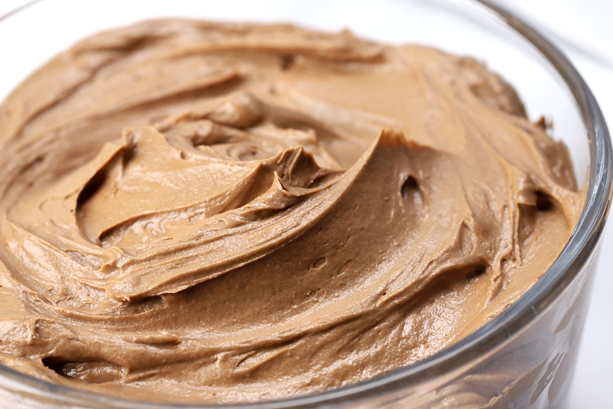 Close up of chocolate frosting in a bowl.