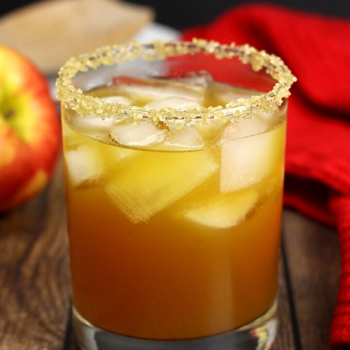 Apple pie cocktail in a lowball glass.