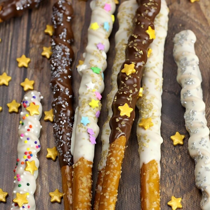 Magic wand pretzels laying in a pile on a wood counter top.