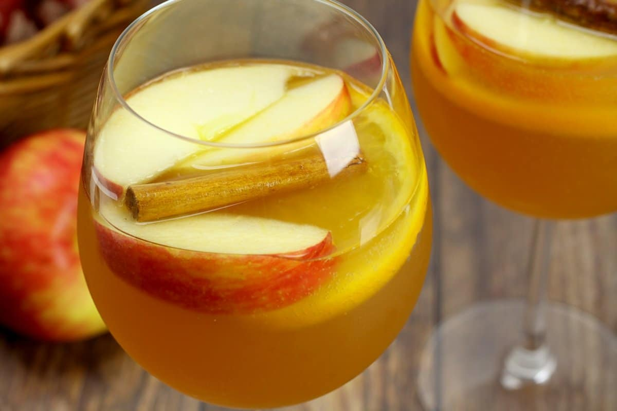 Sliced apples and oranges in a sangria.