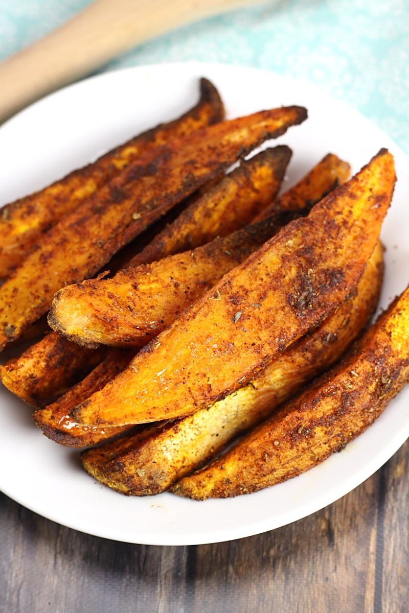 Sweet potato wedges coated in cajun seasoning.