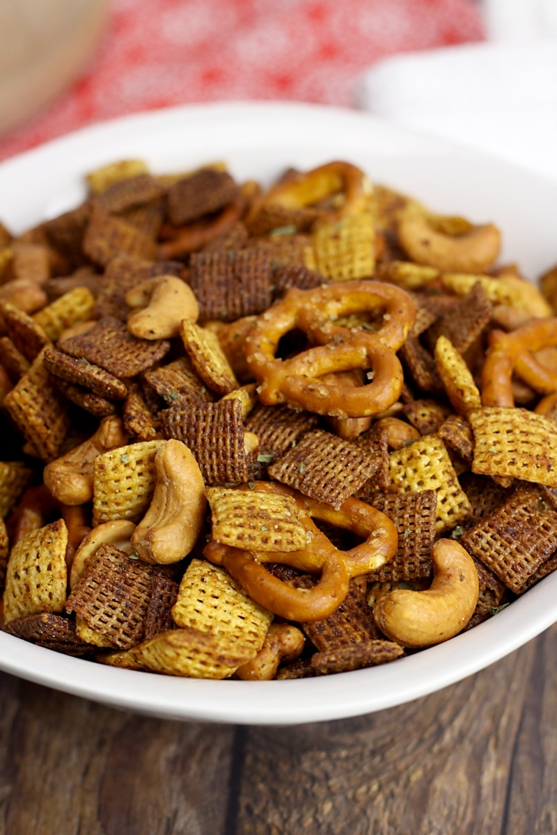 Chex cereal, pretzels, and cashews in a snack mix.