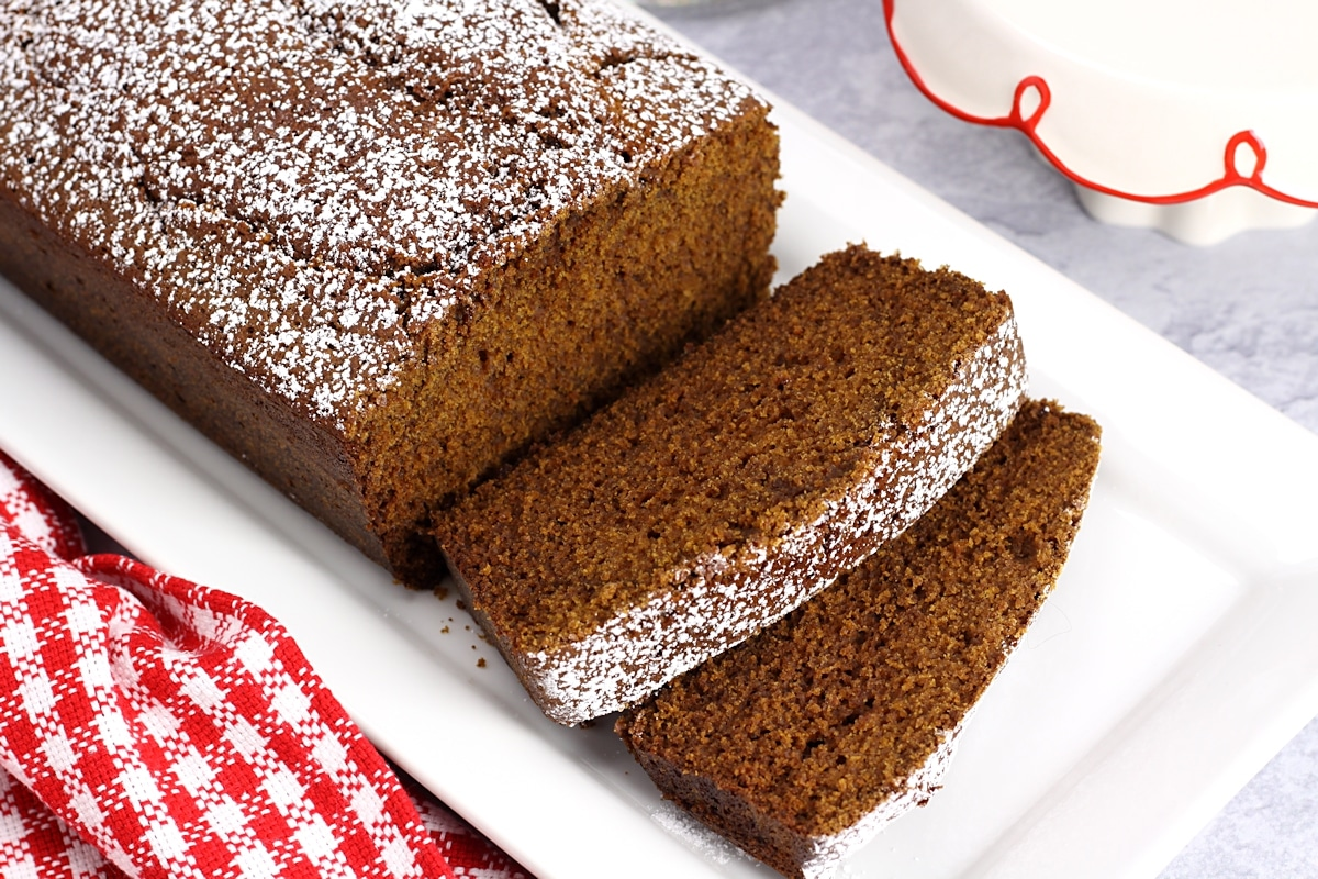 Slices of gingerbread topped with powdered sugar.