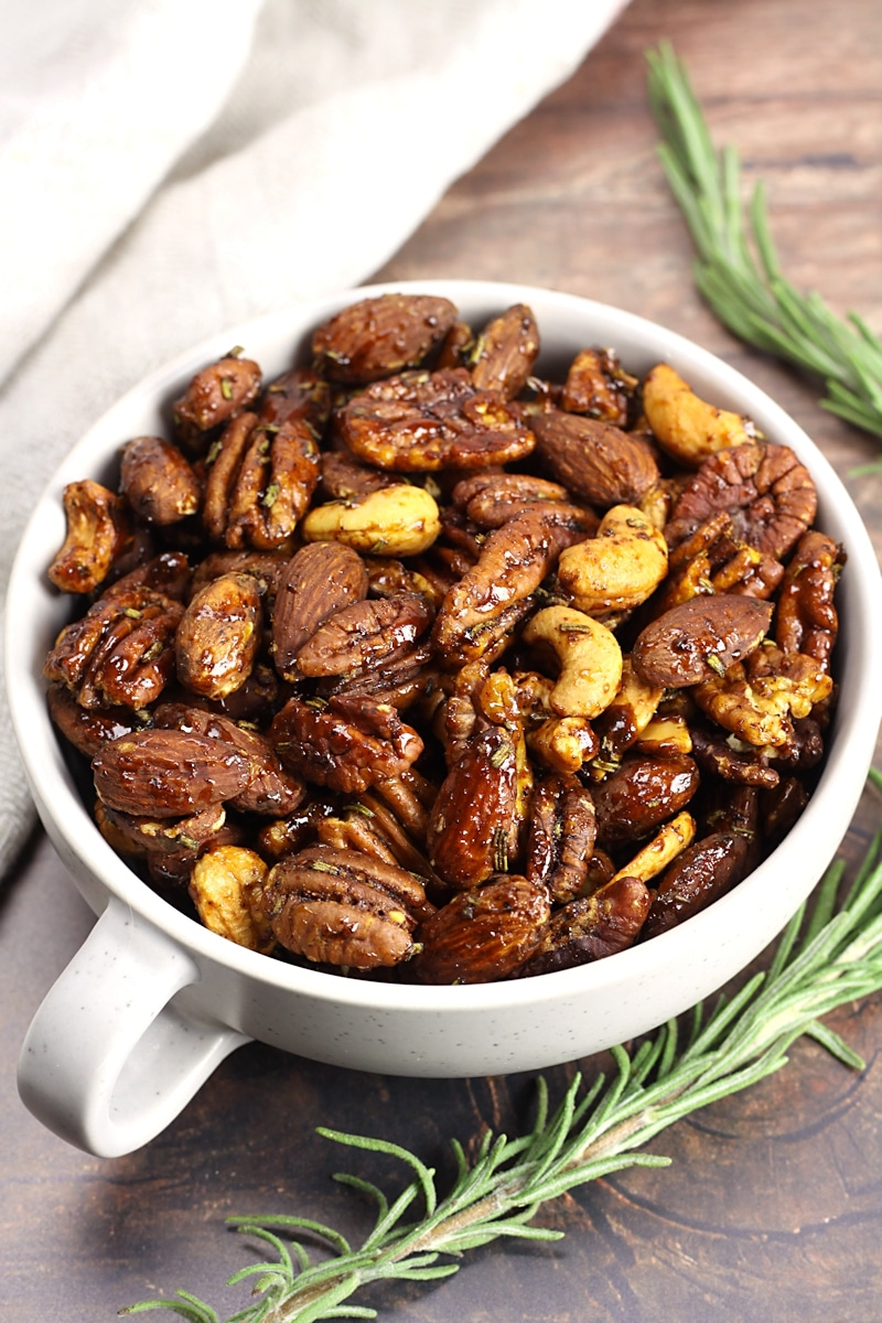 Glazed mixed nuts in a bowl.