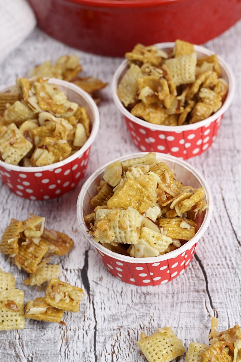 Small red paper cups filled with snack mix.