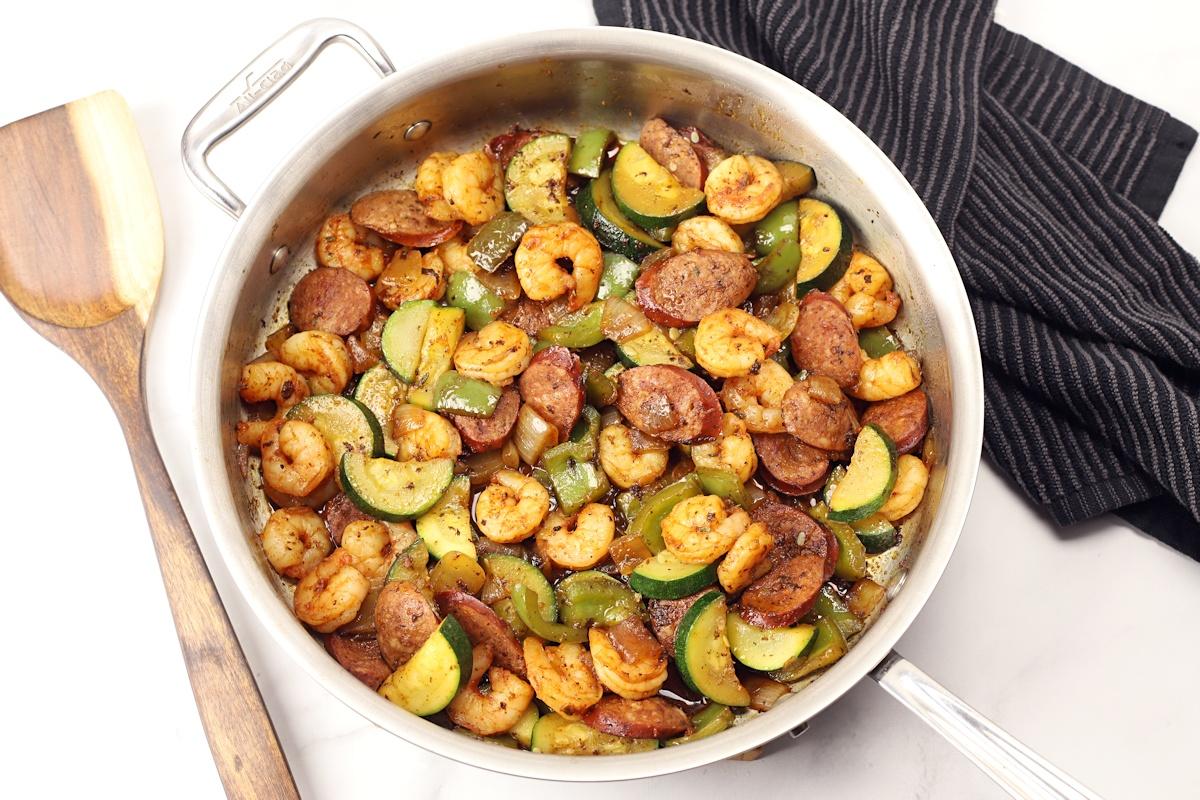 Cajun shrimp and sausage in a saute pan.