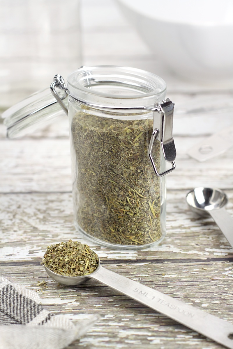A spice jar filled with herbs.