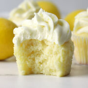 Lemon cupcake with a bite missing.