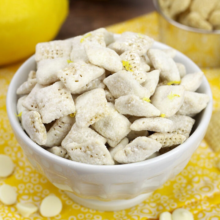 A decorative white bowl filled with lemon puppy chow.