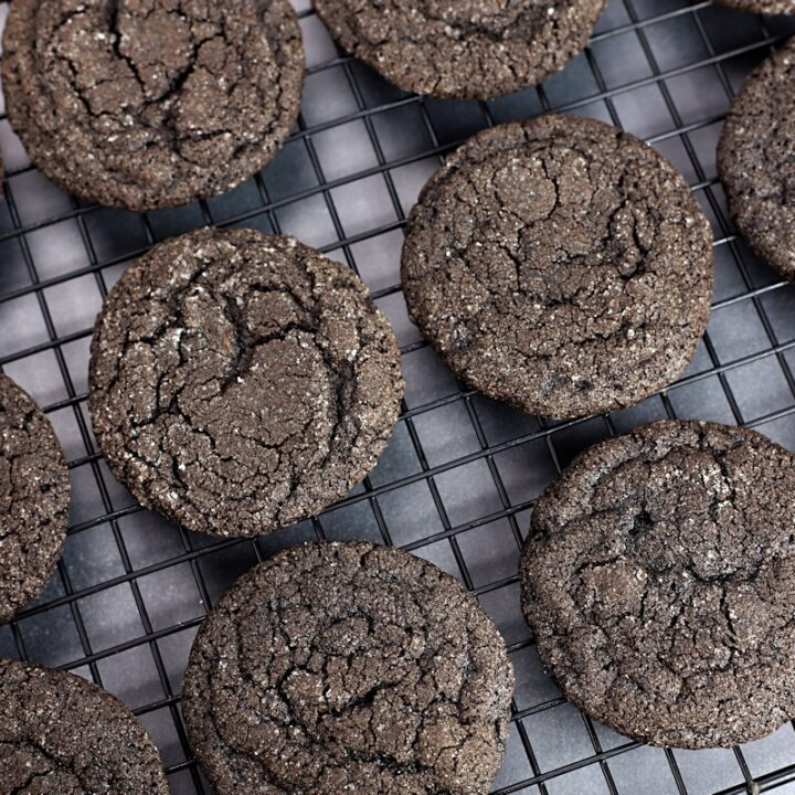 Dutch cocoa cookies on a cooling rack.