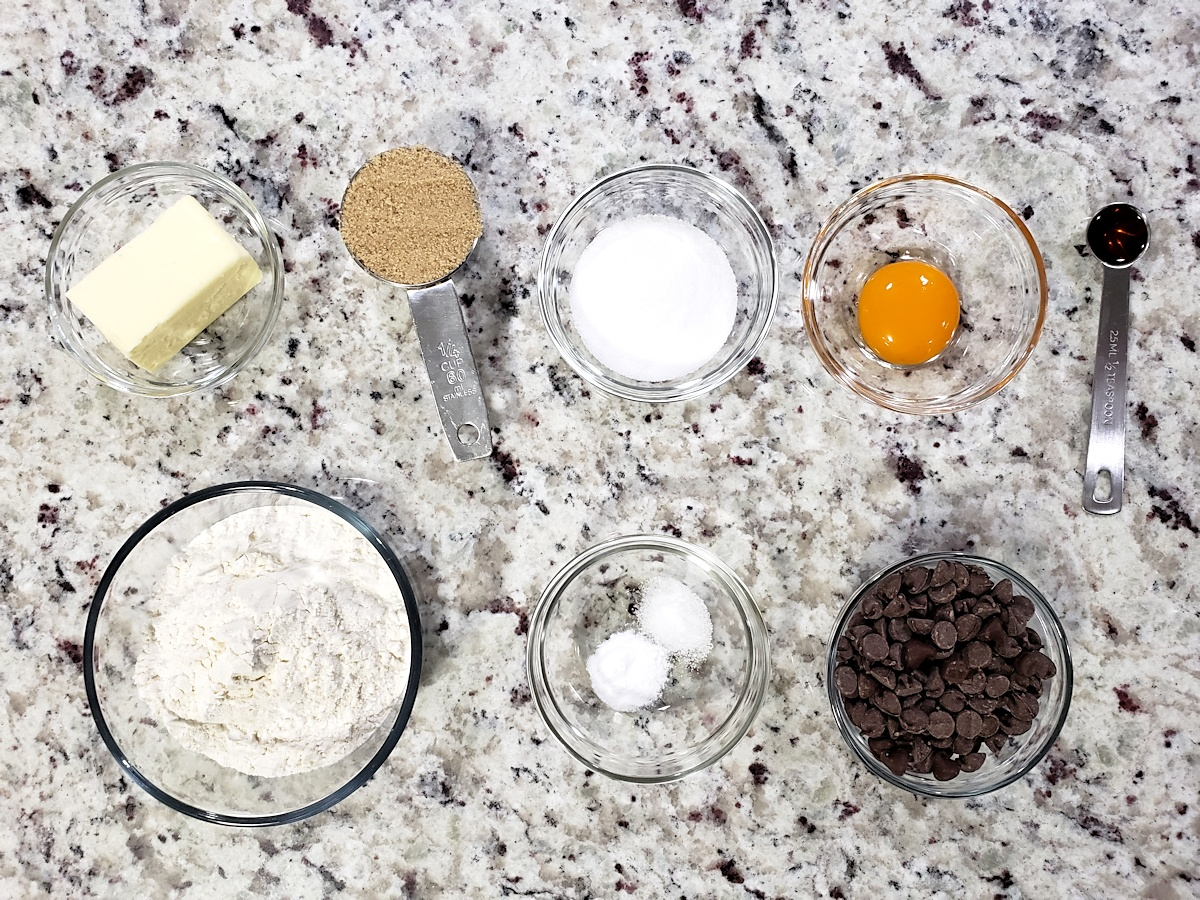 Ingredients to make a small batch of chocolate chip cookies.