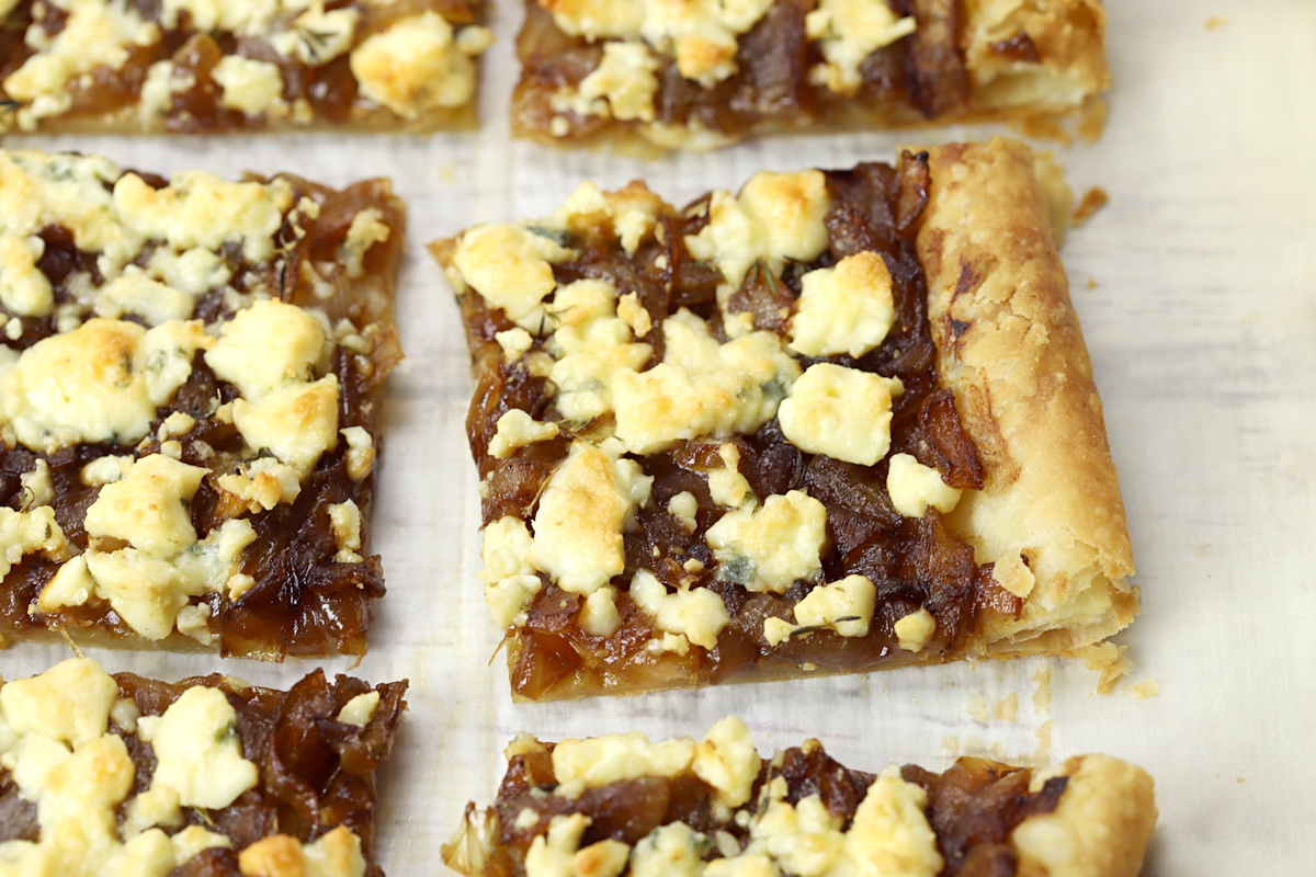 Close up of gorgonzola cheese on top of a tart.
