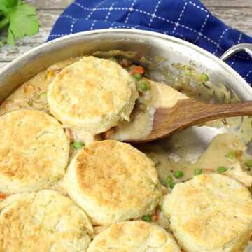 Serving a biscuit from the pan.