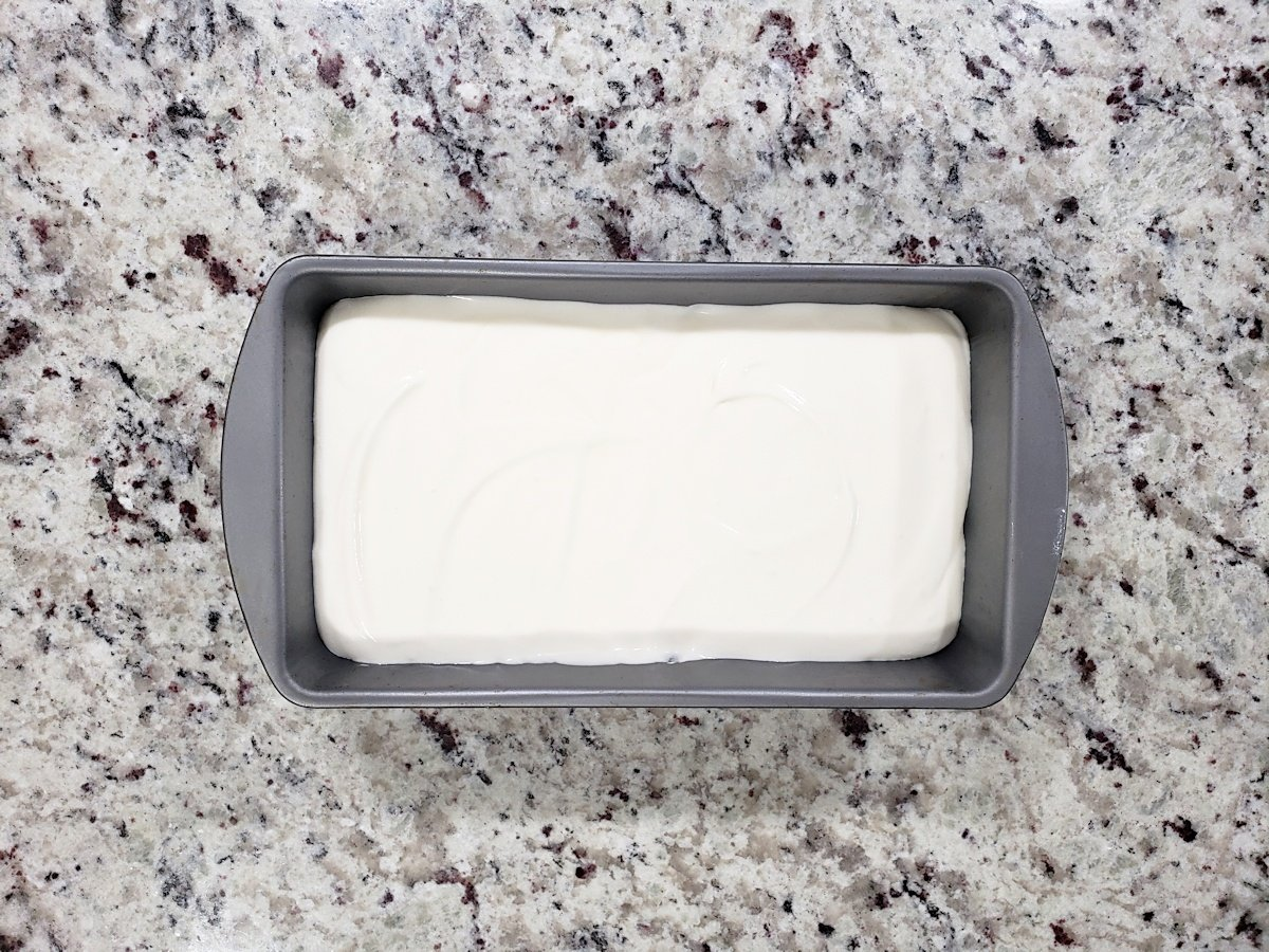 Ice cream poured into a loaf pan, ready to be frozen.