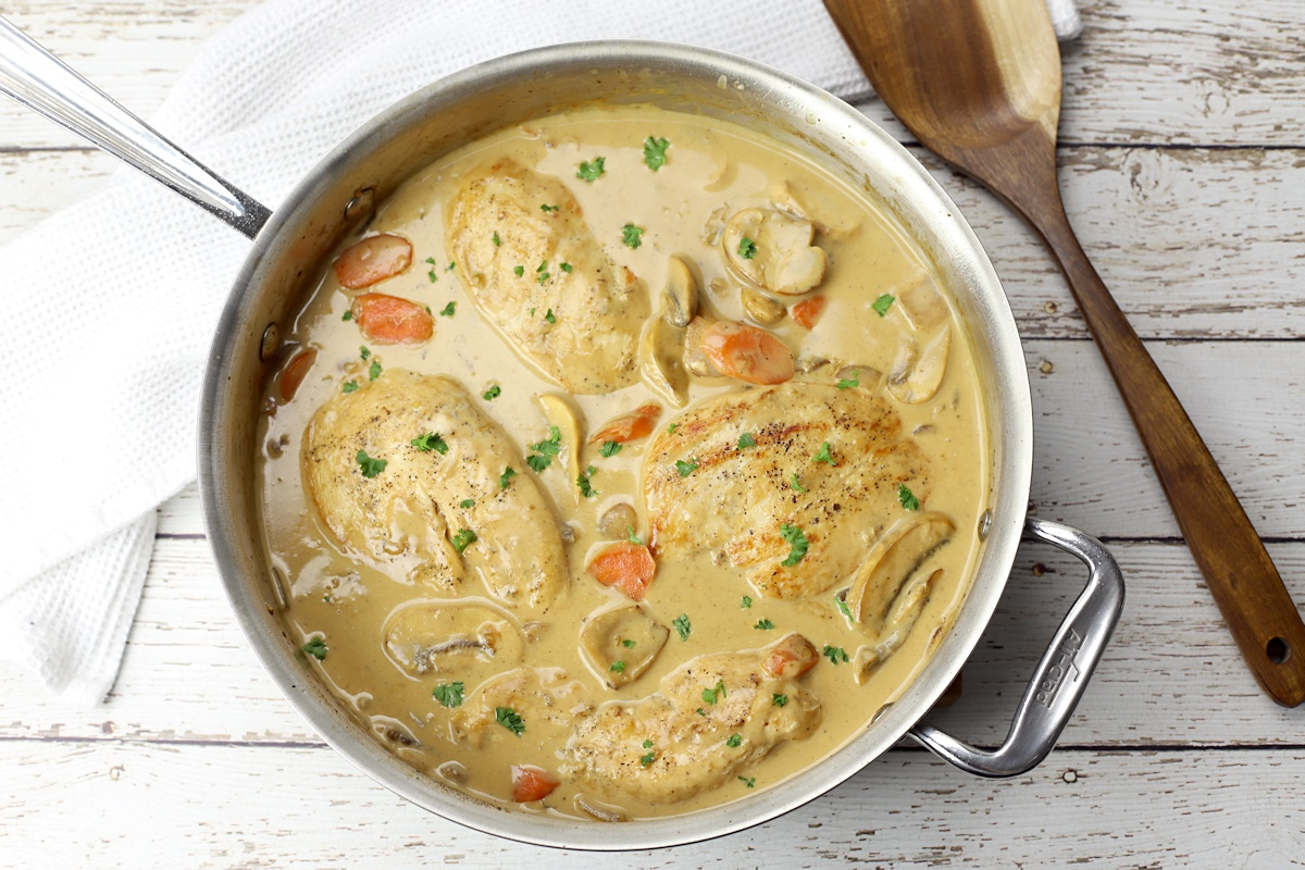 Chicken fricassee in a saute pan.