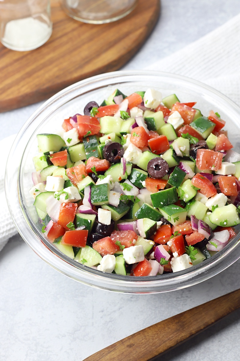 Salad with cucumbers, tomatoes, olives, and feta cheese.