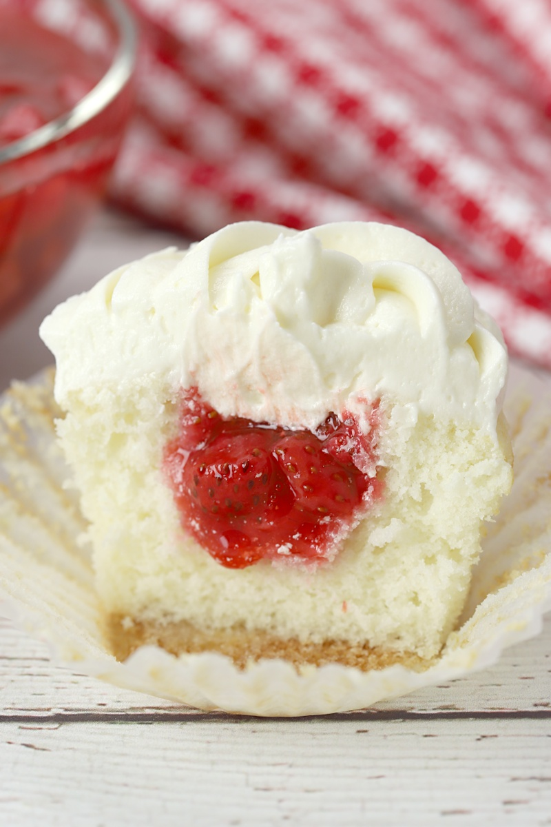 Strawberry filling inside a white cupcake.