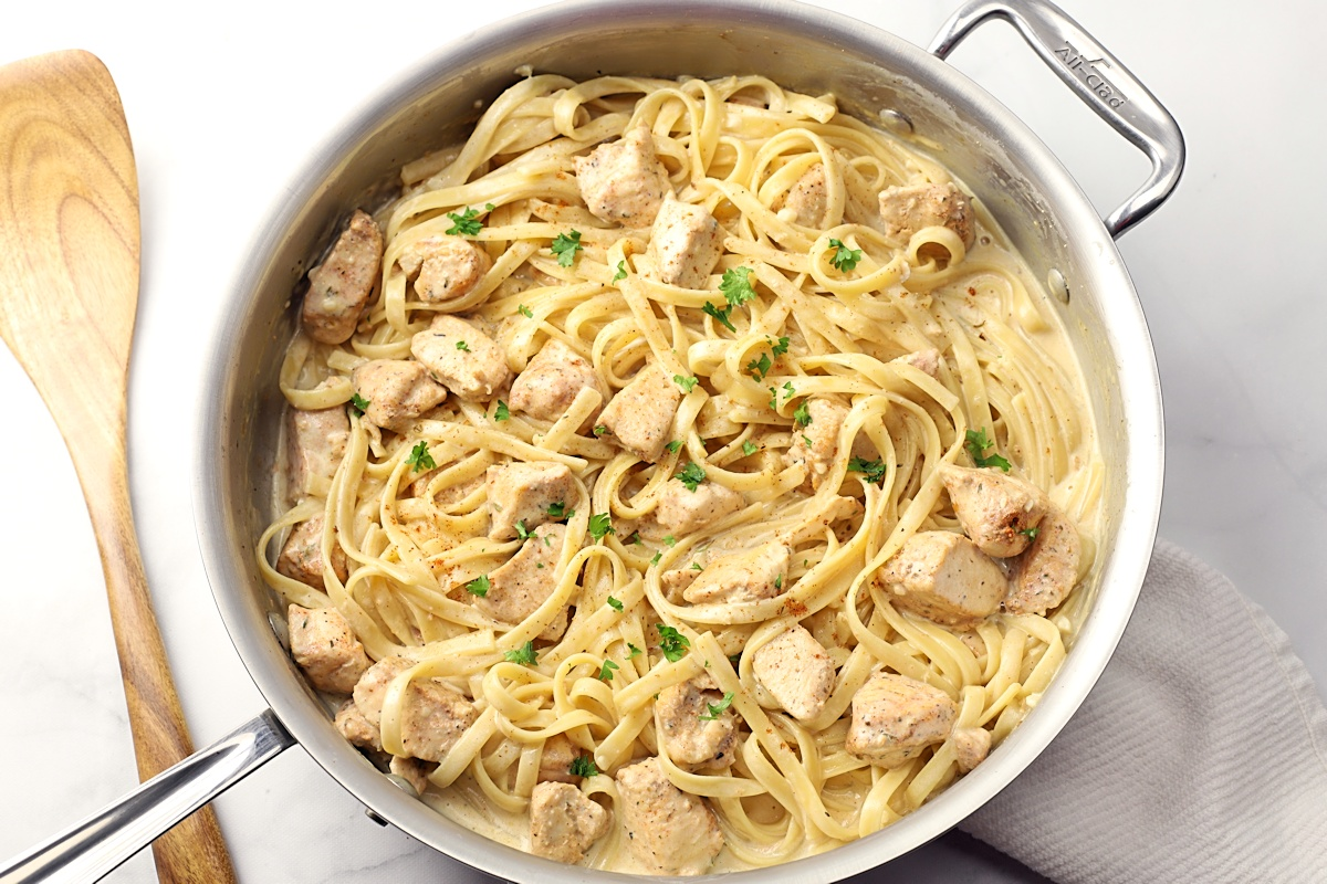 Saute pan with chicken alfredo.