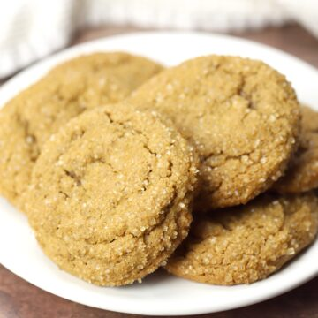 White plate filled with molasses cookies.