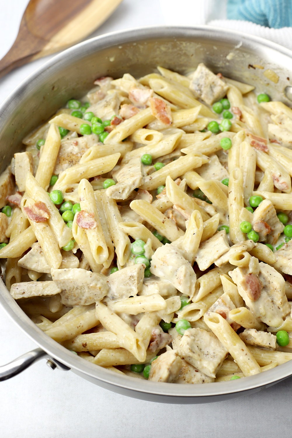 Bits of turkey, peas, and bacon with penne pasta.