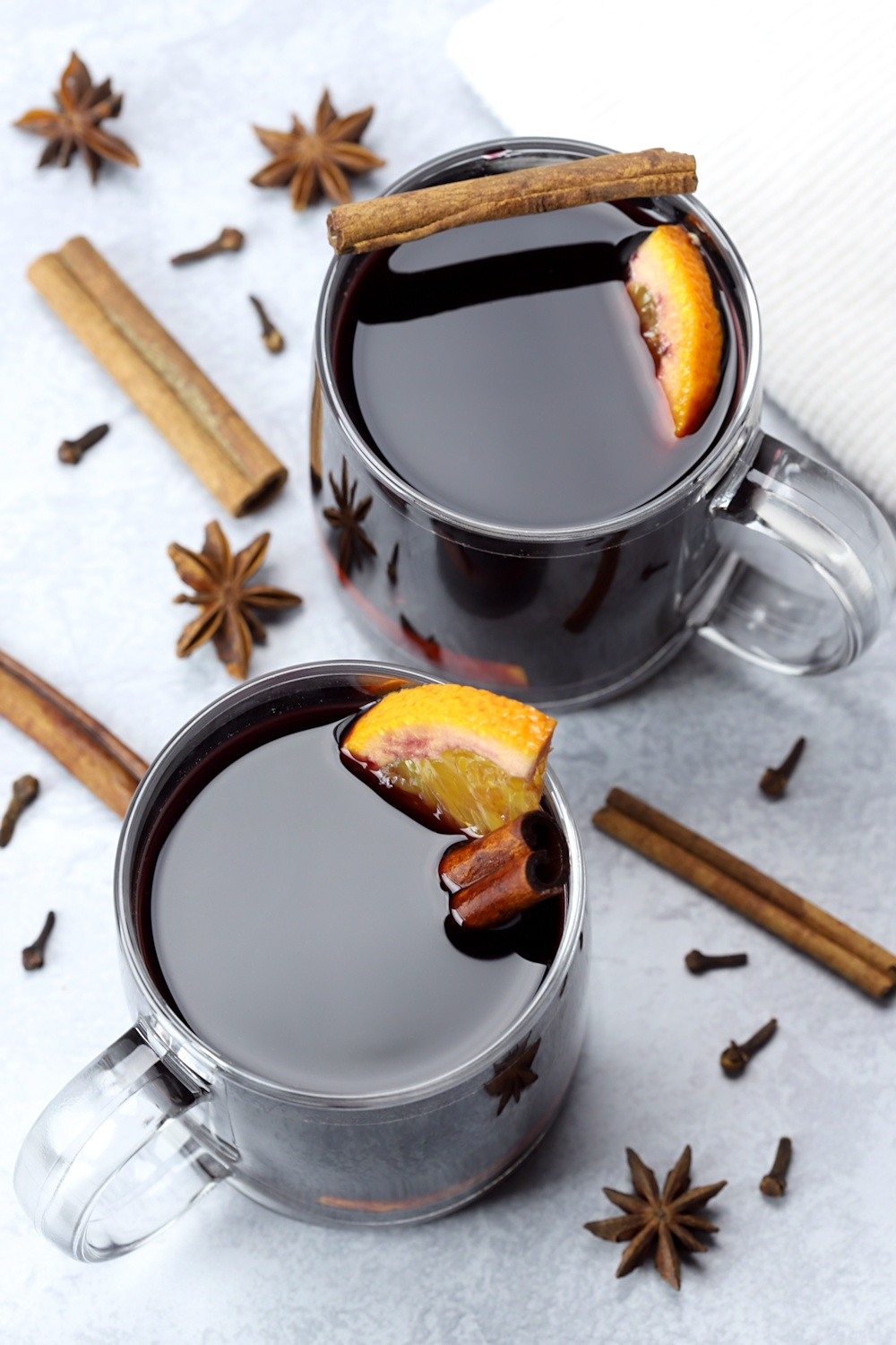 Two glass mugs filled with mulled wine.