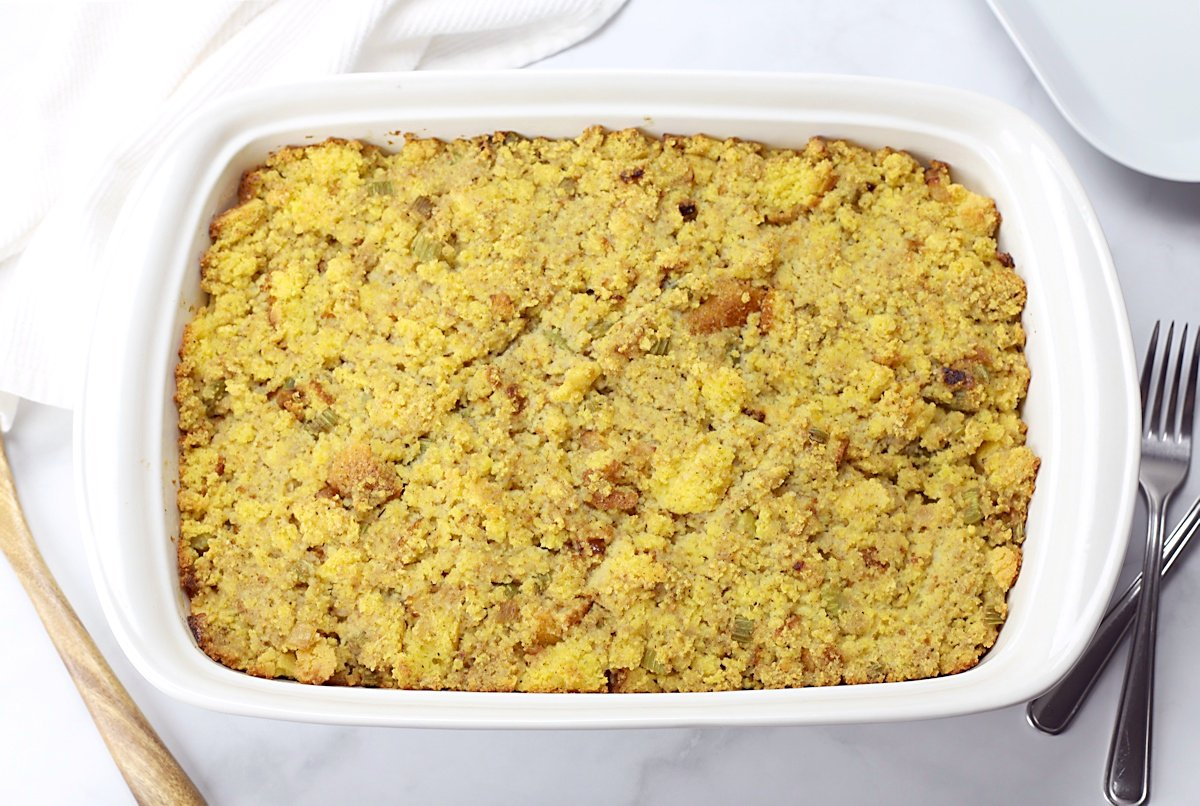 A white 9x13 pan filled with southern cornbread dressing.