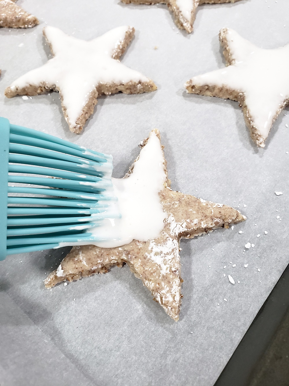Frosting cookies with a meringue topping.