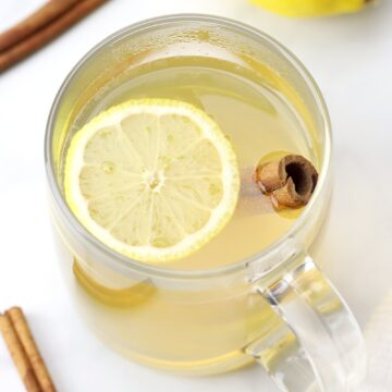 Glass mug filled with hot toddy.