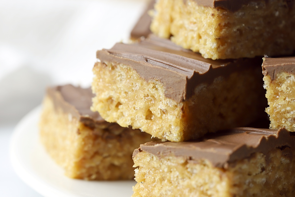 Rice crispies peanut butter bars topped with chocolate.