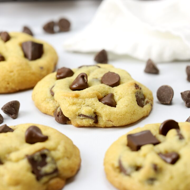Chocolate chip cookies on a marble counter top.