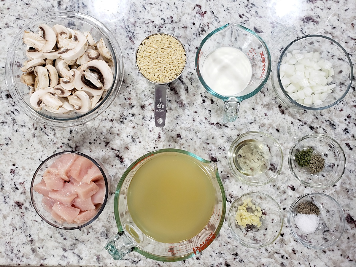 Ingredients to make a chicken and mushroom skillet.