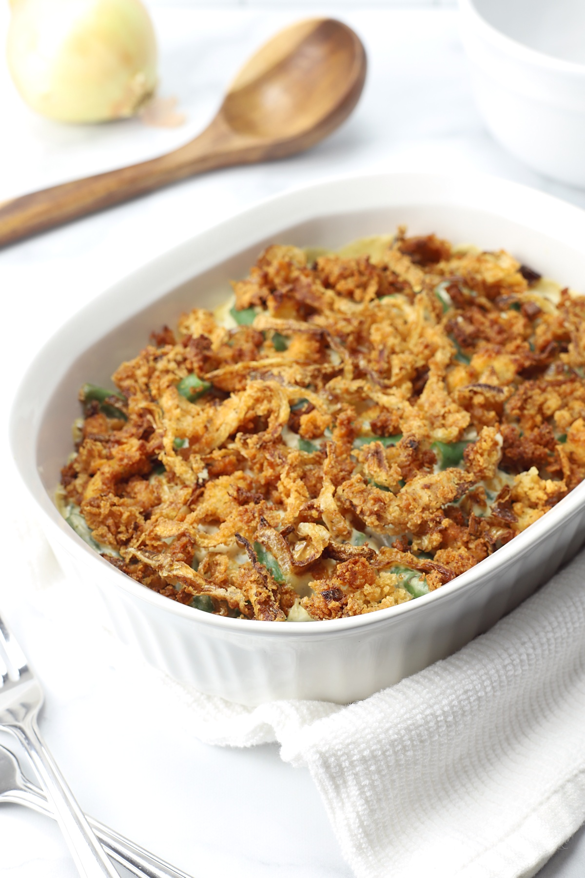 Green bean casserole in a white dish.
