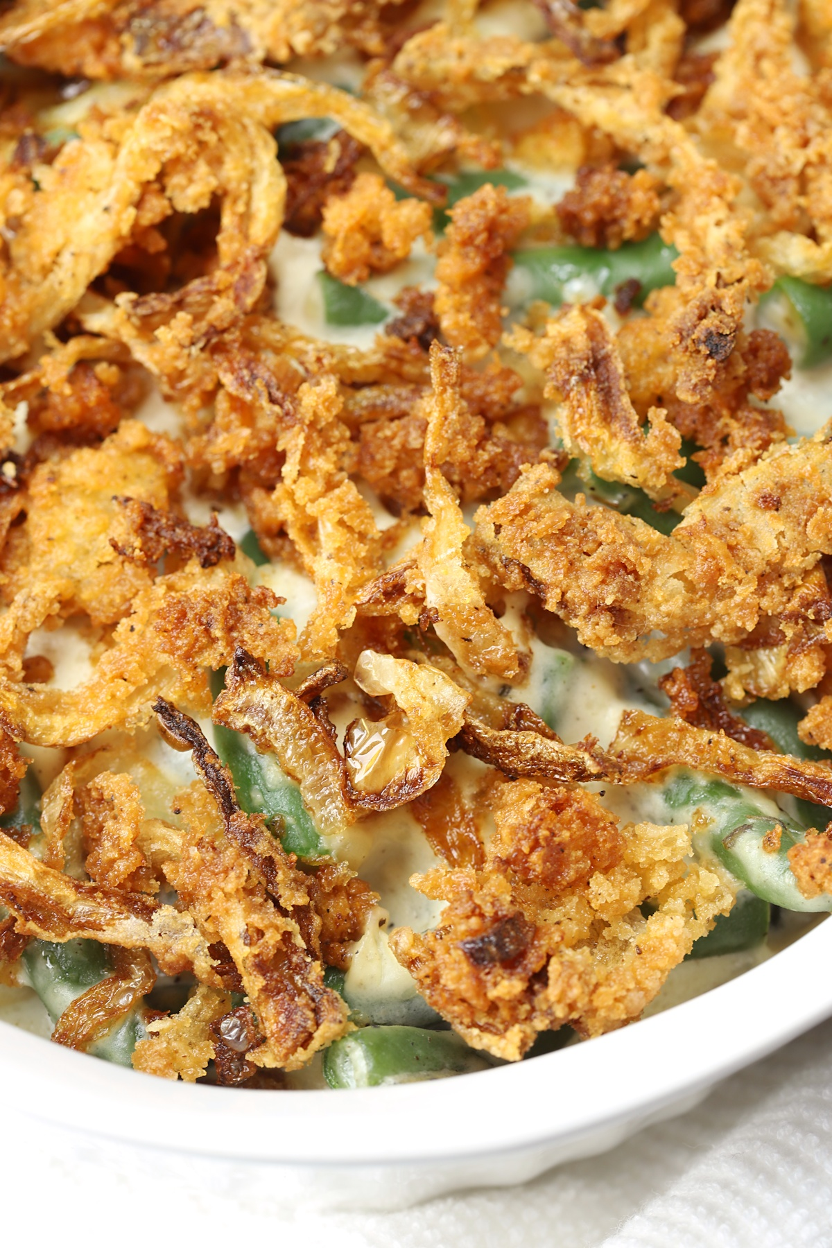 Close up of fried onions on top of green bean casserole.