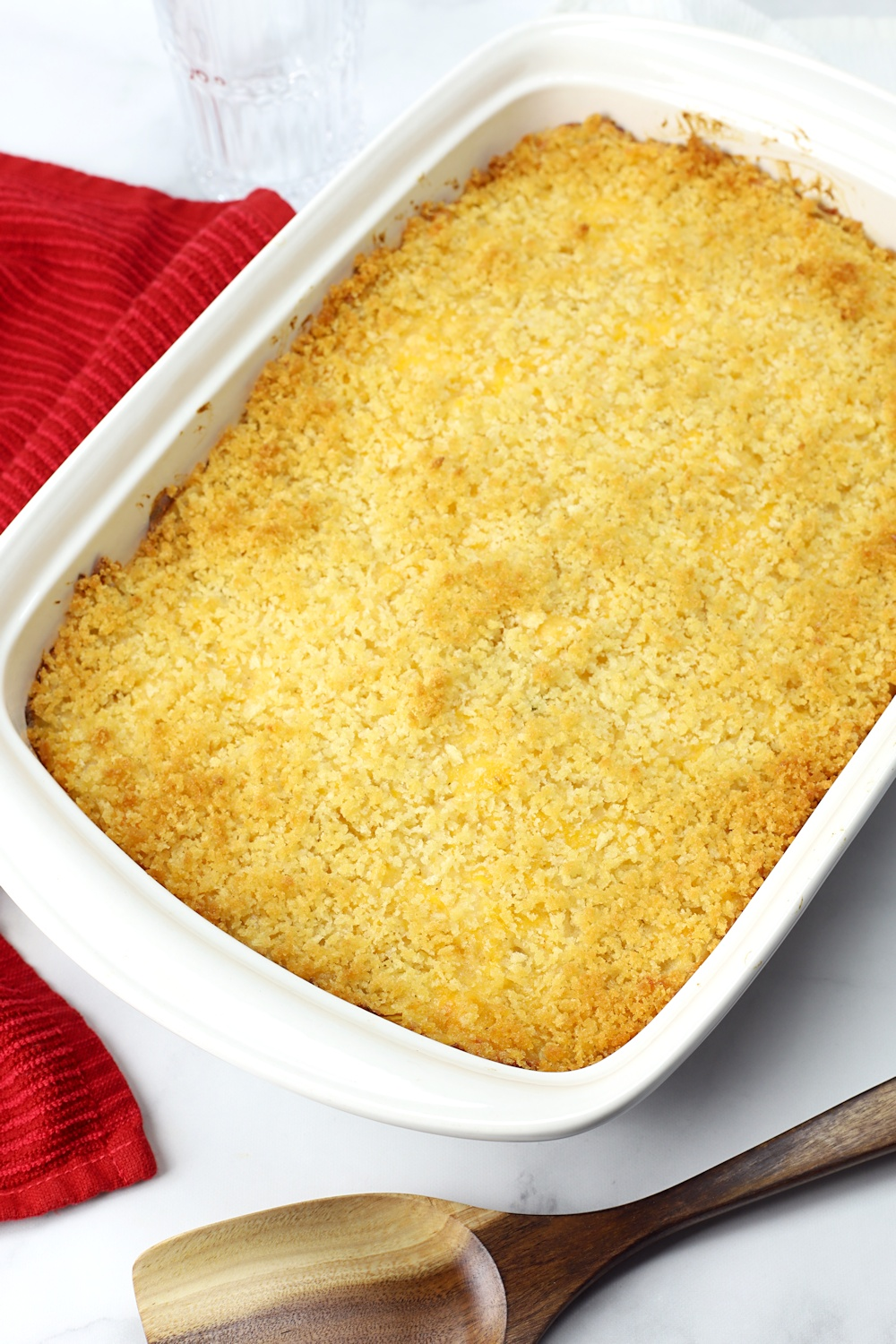 Hash brown casserole in a white baking dish.
