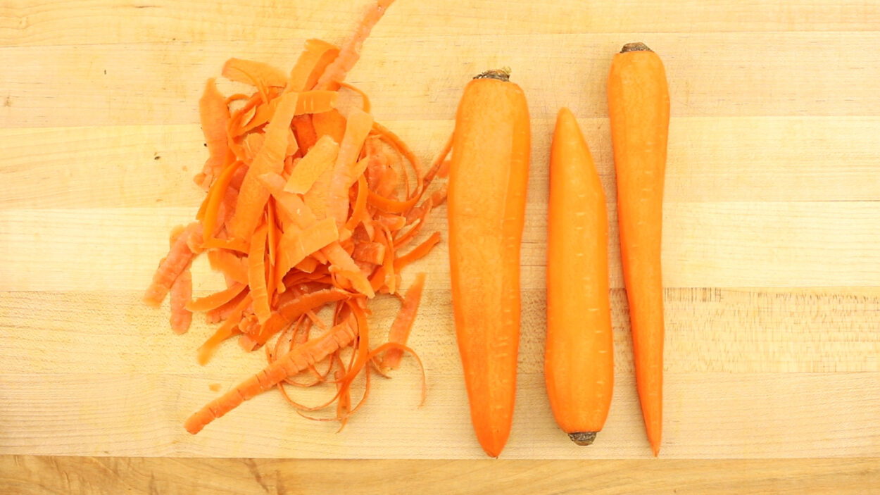 Peeled carrots on a cutting board.