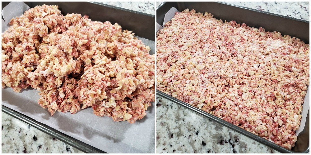Pressing cereal mixture into a 9x13 pan.