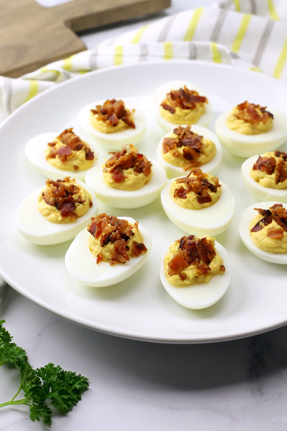 A white plate filled with deviled eggs.
