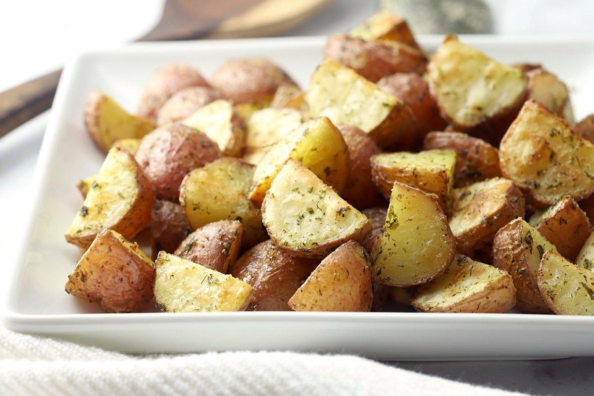 Close up of ranch seasoning on potatoes.