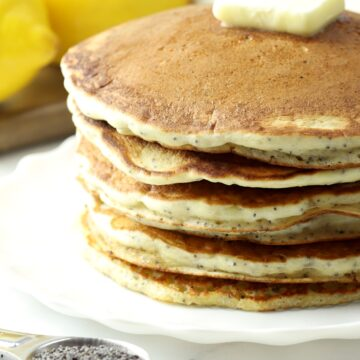 A stack of pancakes with a pat of butter on top.