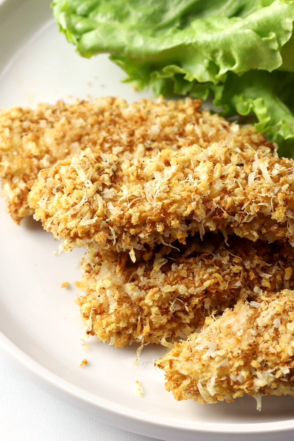 A plate of parmesan crusted chicken tenders.