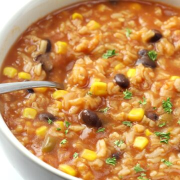 Soup with corn, black beans, and rice.